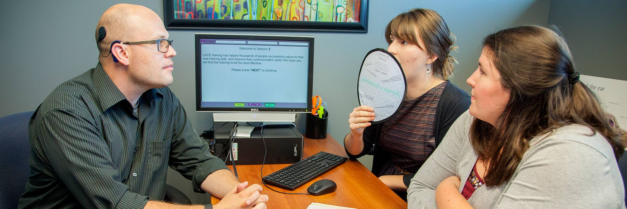 banner-communication-sciences-disorders-ms Graduate student clinicians work with a client with cochlear implants.
