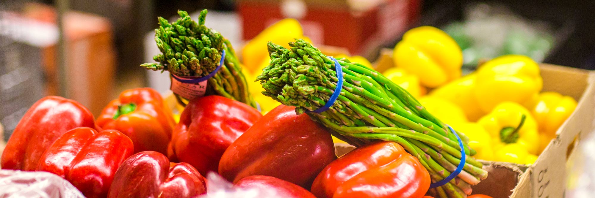 banner-nutritional-sciences-minor Close up photo of asparagus, and red and yellow peppers.
